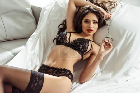 woman in sexy lingerie with handcuffs