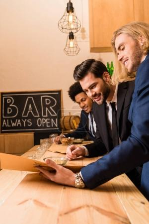 businessmen with menu in bar