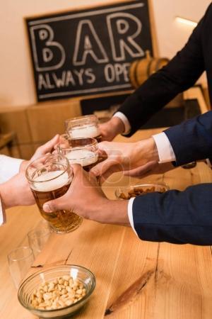 Businessmen drinking beer