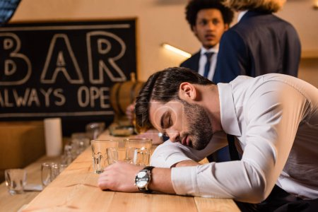 drunk businessman in bar
