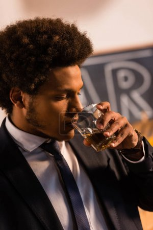 african american businessman drinking whisky