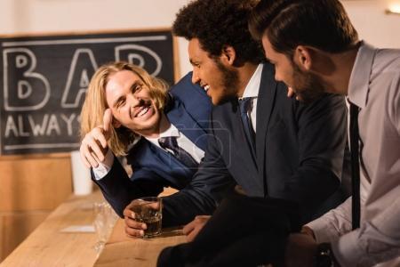 businessmen drinking whiskey in bar