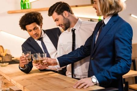 businessmen drinking whiskey in bar