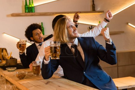 businessmen watching football game in bar
