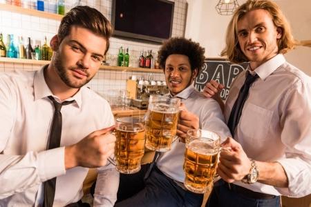 businessmen drinking beer in bar