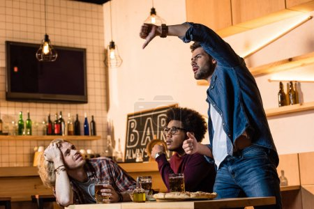 friends watching football game in bar