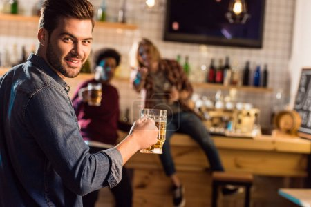man with beer in bar