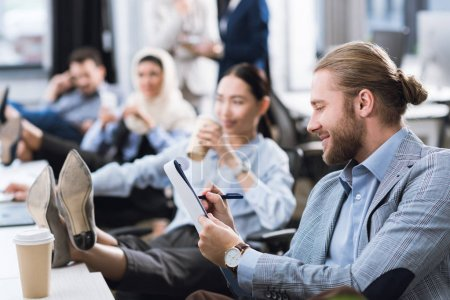 businessman making notes at workplace