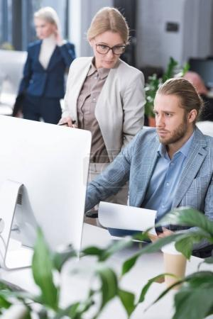 businesswoman checking colleagues work