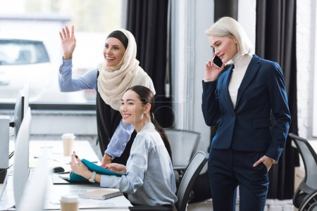 multicultural businesswomen at workplace in office