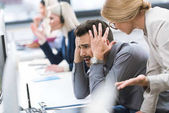 businesswoman pressing on colleague