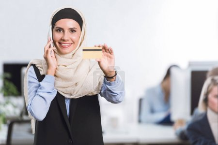 businesswoman with credit card in hand