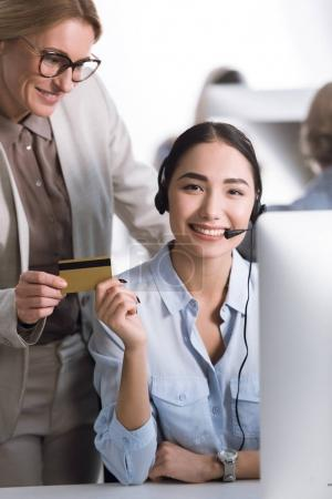 multicultural businesswomen with credit card