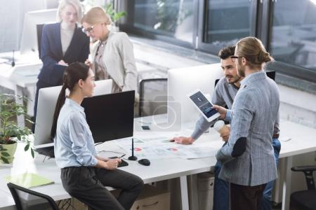 Photo for Selective focus of businesspeople having discussion at workplace in office - Royalty Free Image