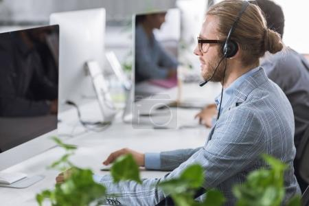 call center operator in headset in office