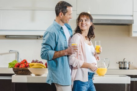 pregnant couple with juice