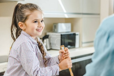kid mixing with ladle