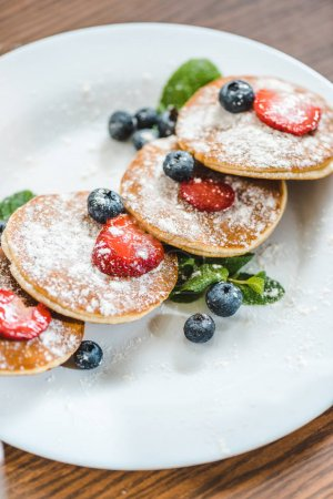 pancakes with berries and mint