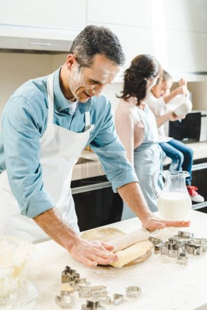Photo for Happy caucasian family in flour making dough at kitchen - Royalty Free Image