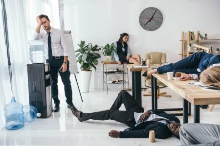 Photo for Group of exhausted business partners sleeping at office - Royalty Free Image