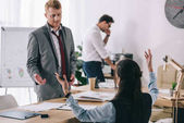 overworked businesspeople having discussion at office