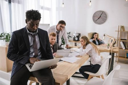 overworked untidy businesspeople working together in conference hall