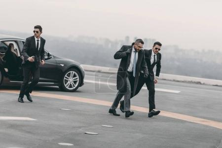 bodyguards protecting businessman on his way from car