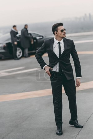 handsome bodyguard with security earpiece and gun