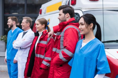 Photo for Ambulance doctors working team standing and posing in front of car - Royalty Free Image