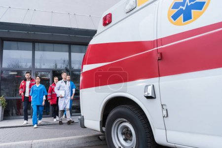 Photo for Paramedic team going from hospital to ambulance - Royalty Free Image