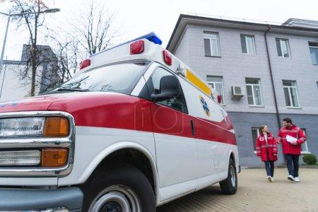 male and female paramedics going to ambulance