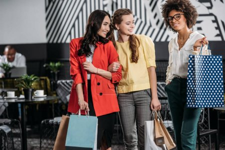 group of young multiethnic women with shopping bags