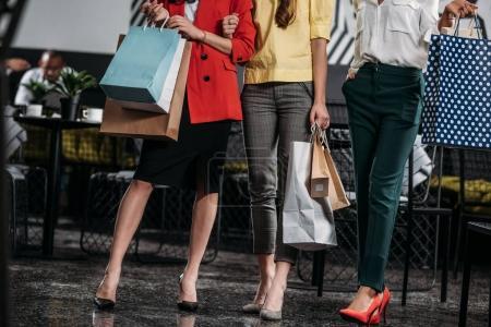 cropped shot of group of stylish women doing shopping