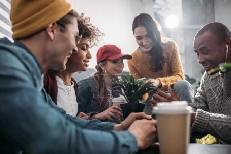 Group of friends spending time together in cafe...