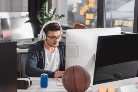 serious young man working on computer at modern office