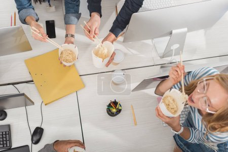 top view of cropped hands with thai food over working table at modern office
