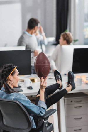 happy young woman resting with ball at office