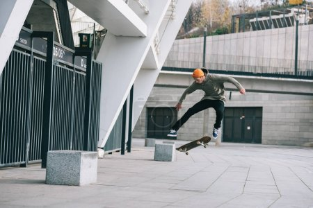 skateboarder performing jump trick in urban location