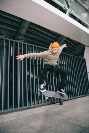 professional skateboarder performing trick in urban location