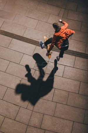 high angle view of skateboarder performing trick