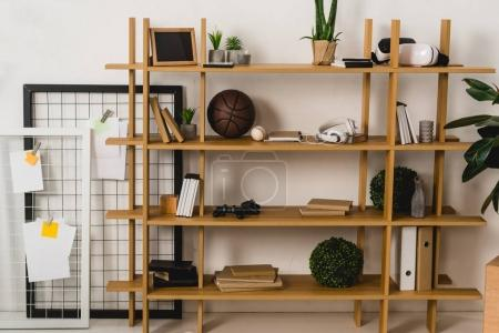 brown wooden shelves with stuff at home