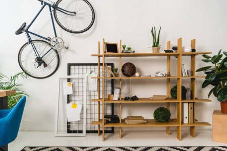 bike on wall and shelves with stuff at home