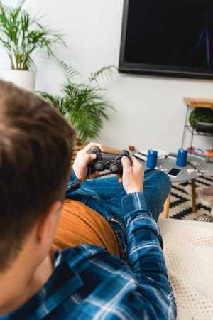 cropped image of teenager playing video game