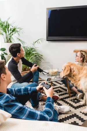 Photo for Boys playing video game using tv flat screen - Royalty Free Image