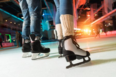 Photo for Cropped shot of couple in skates ice skating on rink - Royalty Free Image