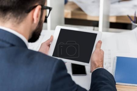 businessman using tablet at working place
