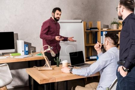 businessmen having meeting about project in office