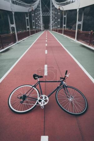 vintage bike on pedestrian bridge