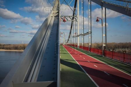 Photo for Empty pedestrian bridge on sunny autumn day - Royalty Free Image