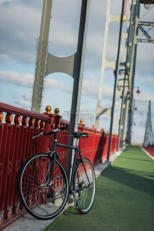 vintage bike on pedestrian bridge on sunny day
